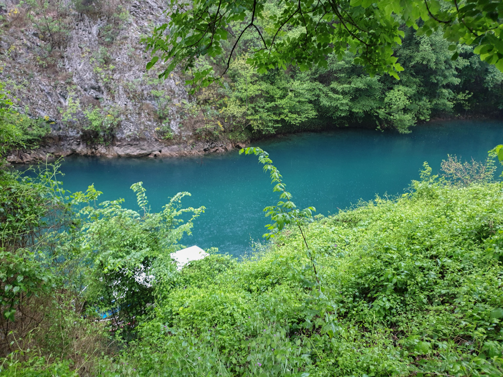 The blue water in Matka Canyon on a rainy day